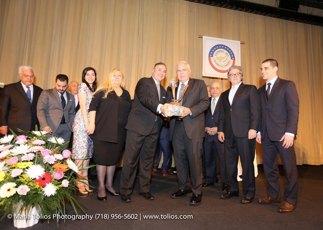 "Andreas Kramvis honored and presented by President Nicholas Karacostas the ""Distinguished Merit Award"""